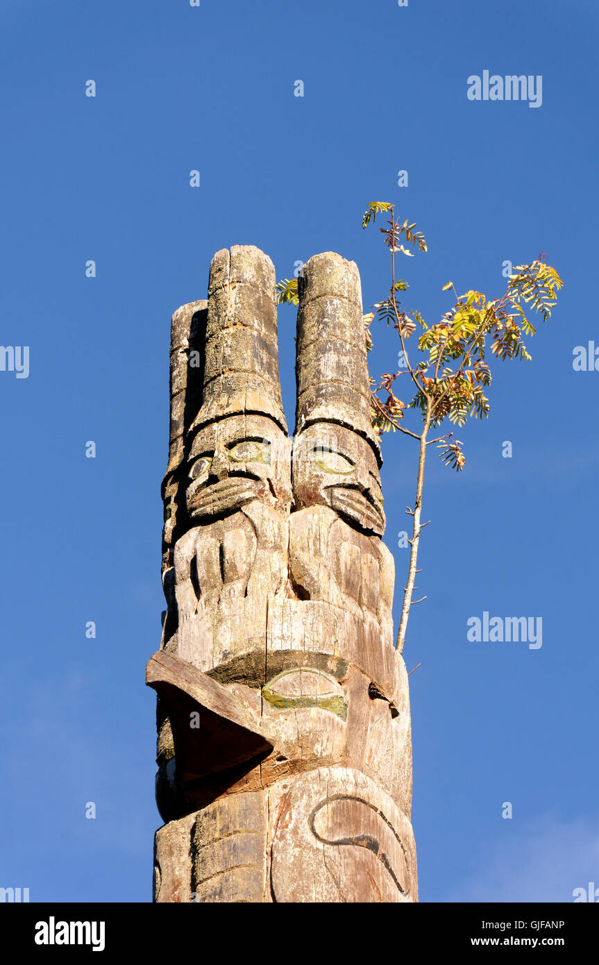 Haida watchman carvings on top of a First Nations totem pole in Cates Park, Deep Cove, British Columbia, Canada - Stock Image