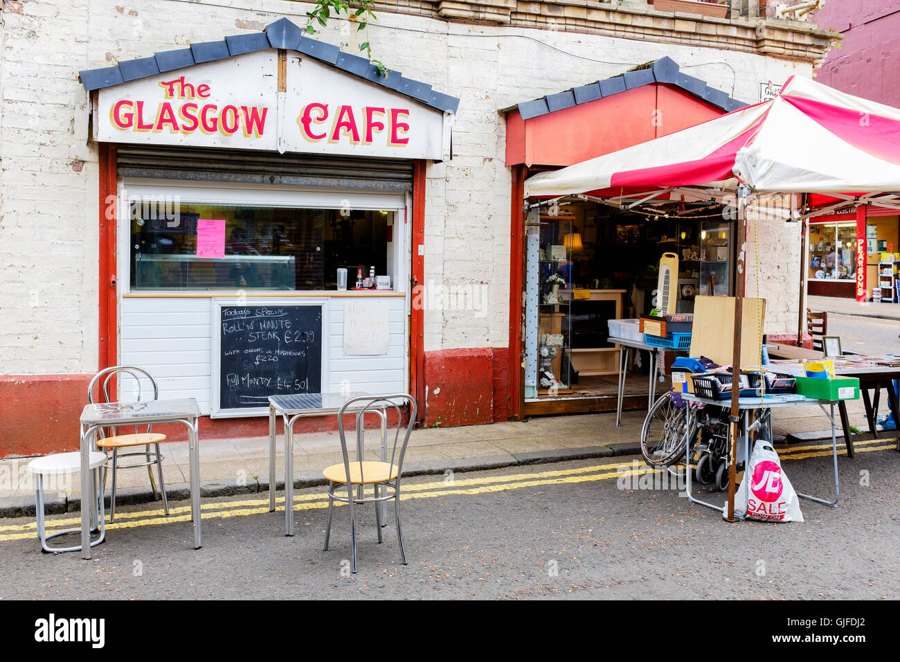 Small cafe and side shop selling secondhand goods, The Barras flea market, Glasgow, Scotland, UK Stock Photo