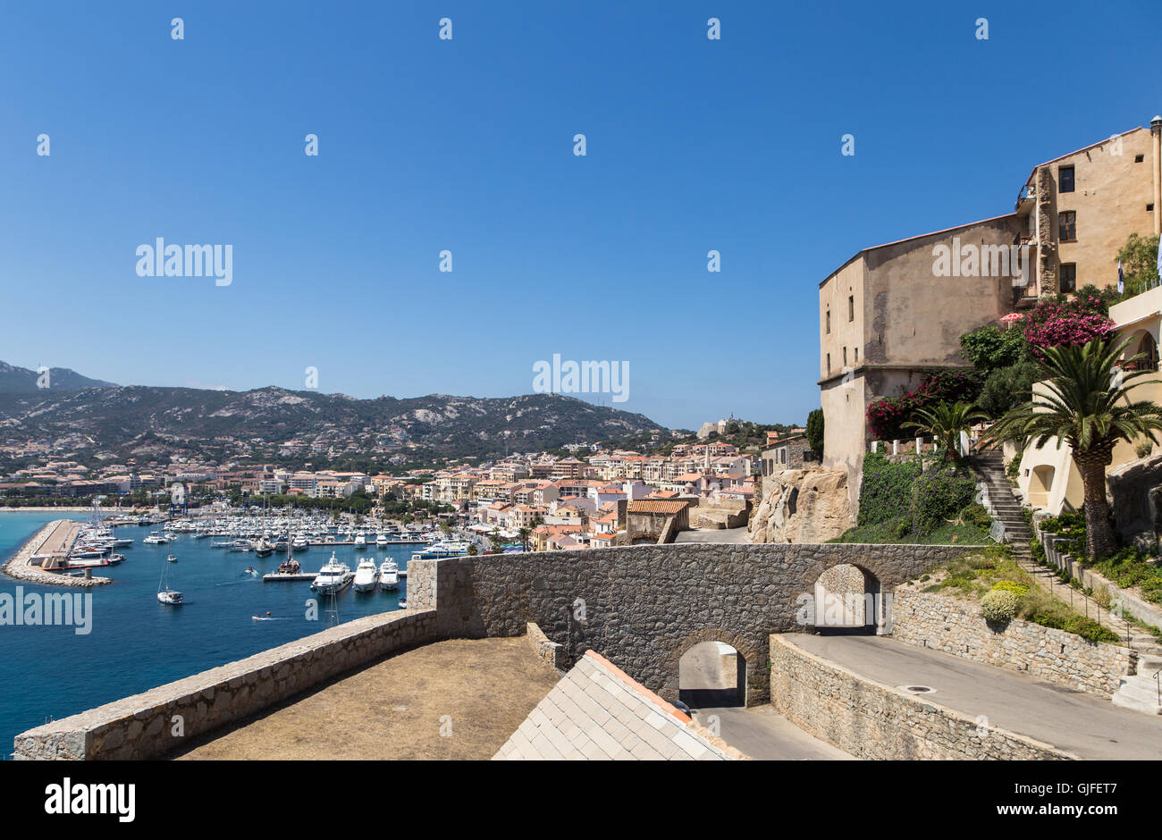 Calvi citadel overlooking the marina in the French island of Corsica. - Stock Image