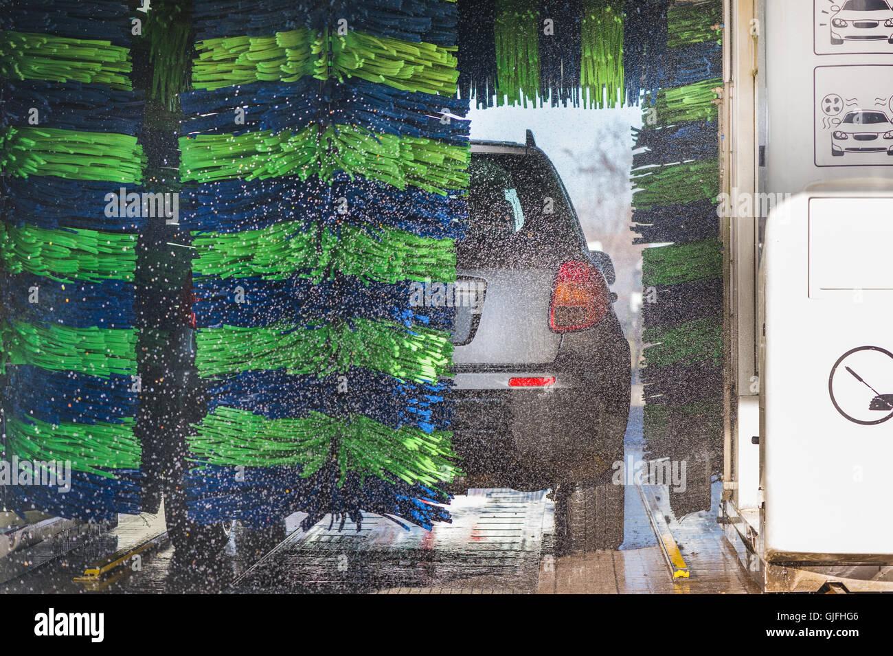 Grey car during washing process - Stock Image