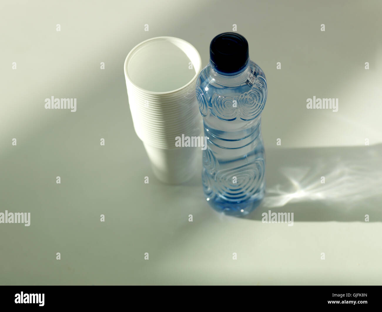 WBottle of Water with disposable cups - Stock Image