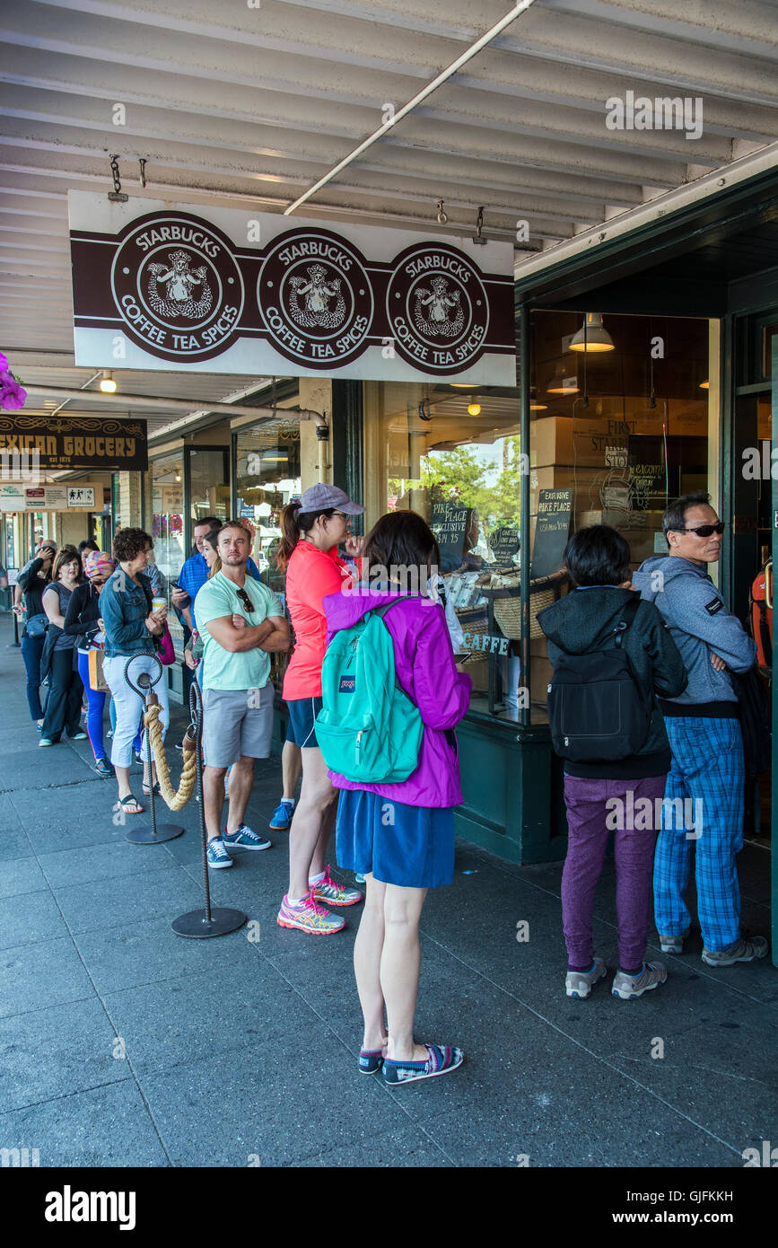 People waiting in line to get into the Original Starbucks coffee place established in 1971 at Pike Place Market, - Stock Image