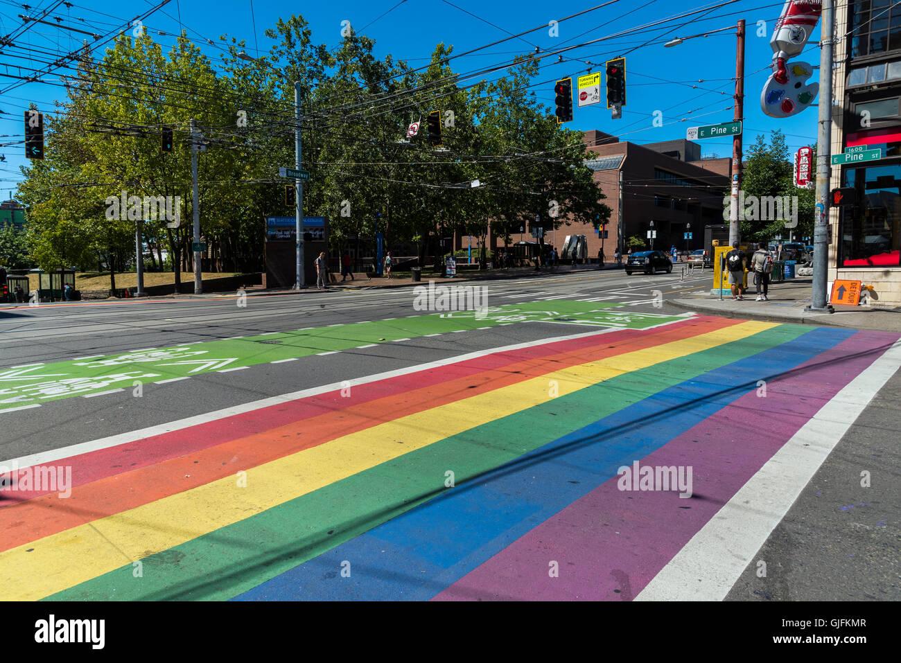 Gay-themed rainbow crosswalk in Capitol Hill district, Seattle, Washington, USA - Stock Image