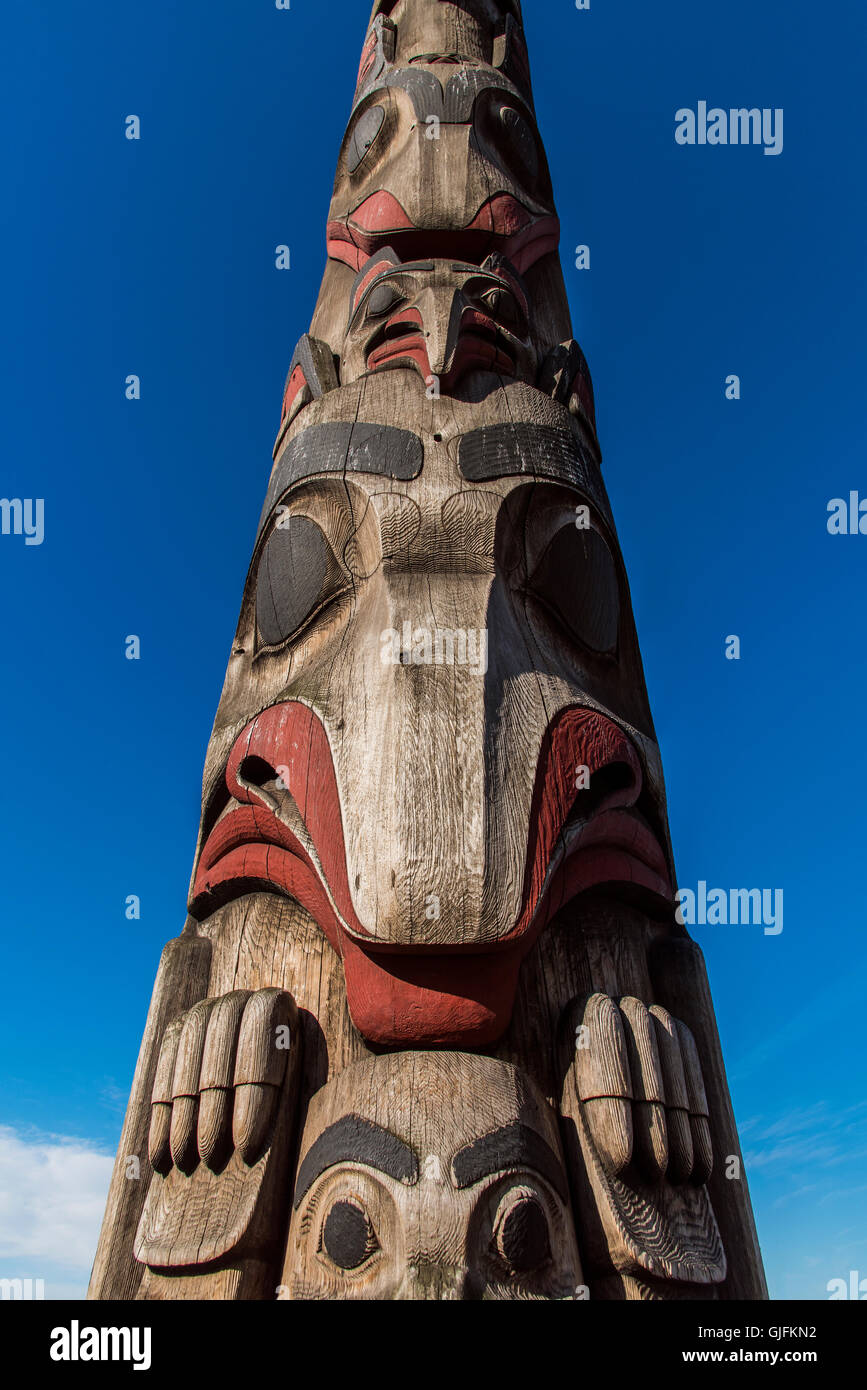 Cedar totem pole at Victor Steinbrueck Park, Seattle, Washington, USA - Stock Image
