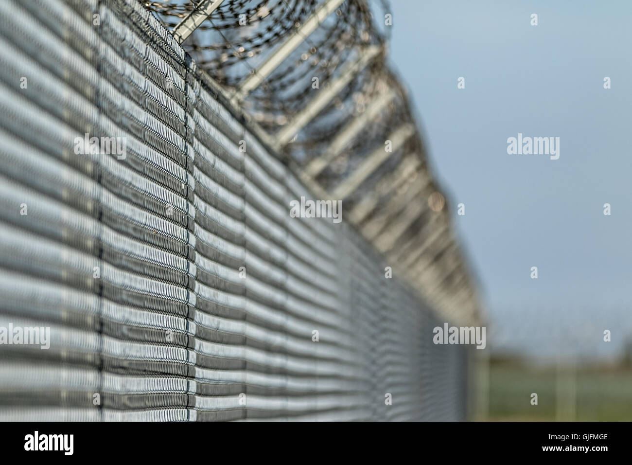 Barbwire fence against illegal immigration concept picture - Stock Image