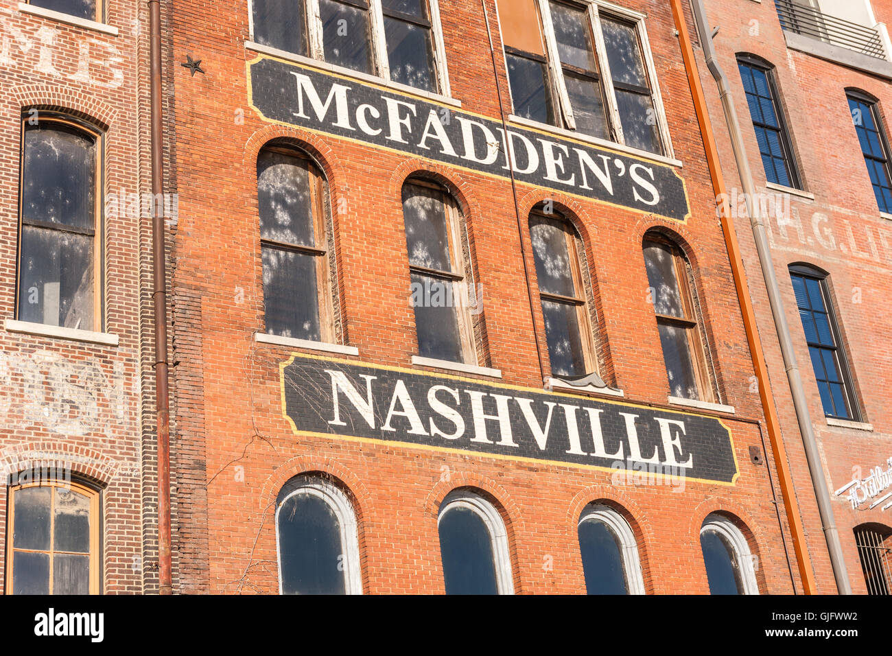 Historic Front Street Warehouses, now converted for other uses, line 1st Street behind Riverfront Park in Nashville, - Stock Image