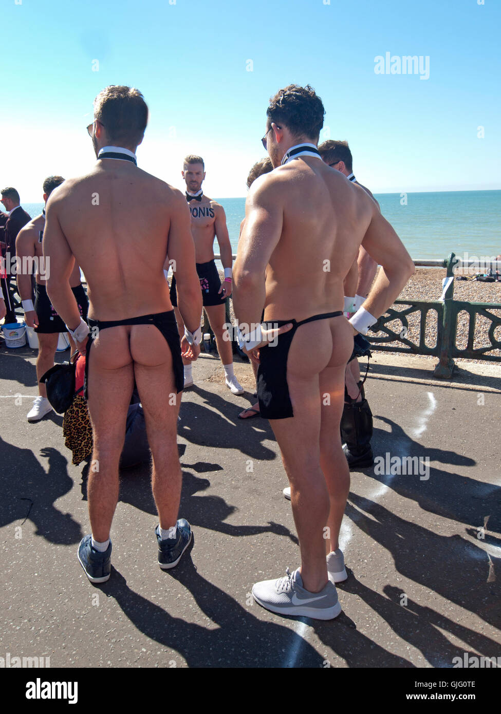 On the promenade at Hove the parade for Brighton Pride 2016 assembles - Stock Image