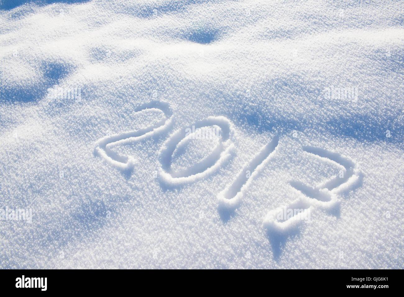 new years date 2017 written in fresh powder snow - Stock Image