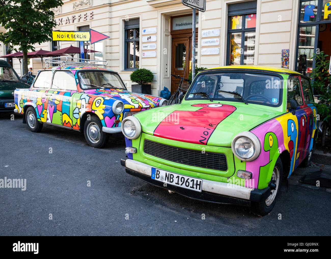 Two old Trabants with  psychedelic paint jobs, outside Noir Berlin, Mitte, Berlin, Germany. - Stock Image