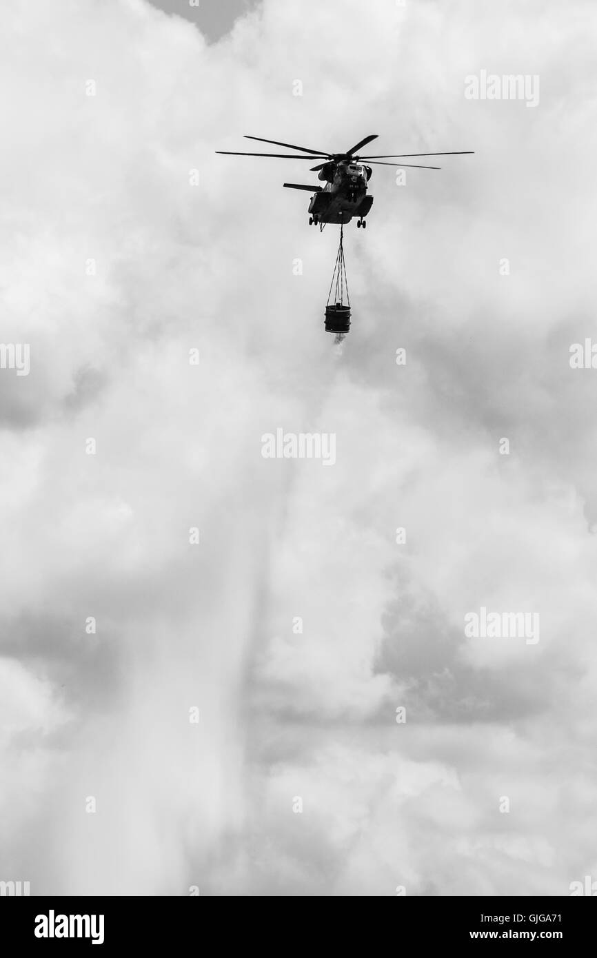 Heavy-lift cargo helicopter Sikorsky CH-53 Sea Stallion of the German Army with equipment for fighting fires. - Stock Image