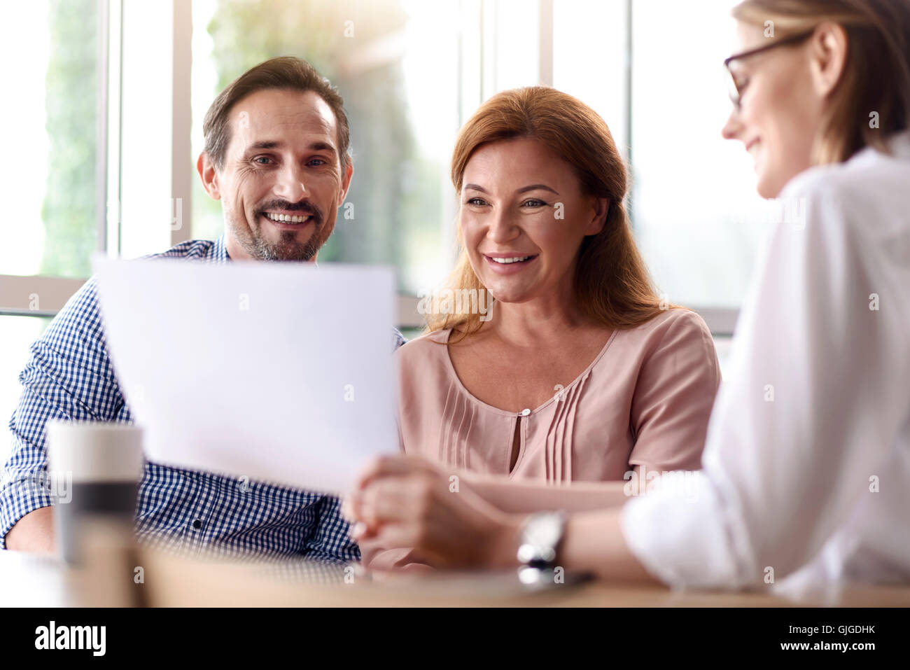 Cheerful colleagues sharing ideas. - Stock Image
