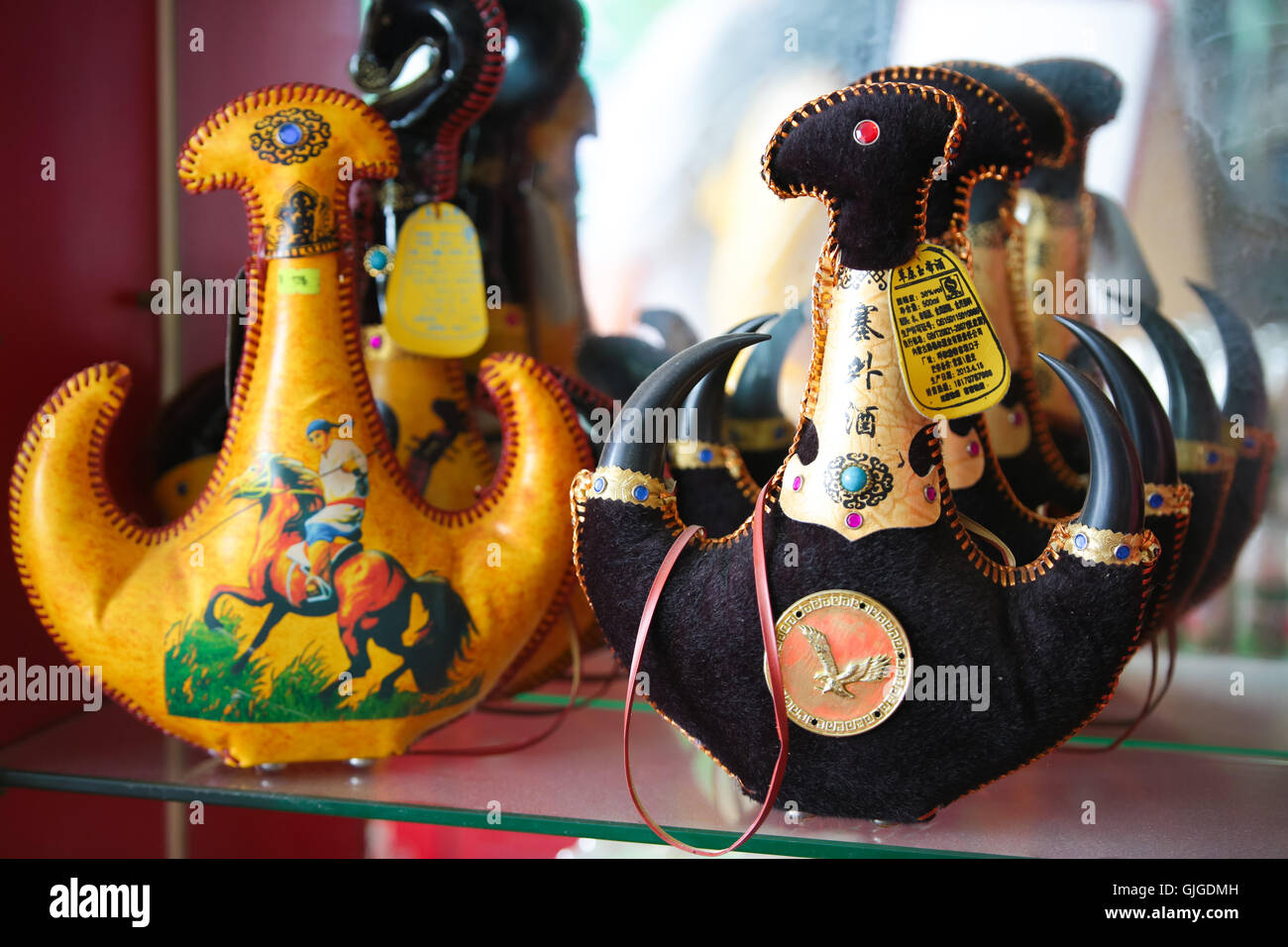 China mongolian liquor in fancy leather pouch on display rack of a local store in Guangzhou, Guangdong, China. - Stock Image
