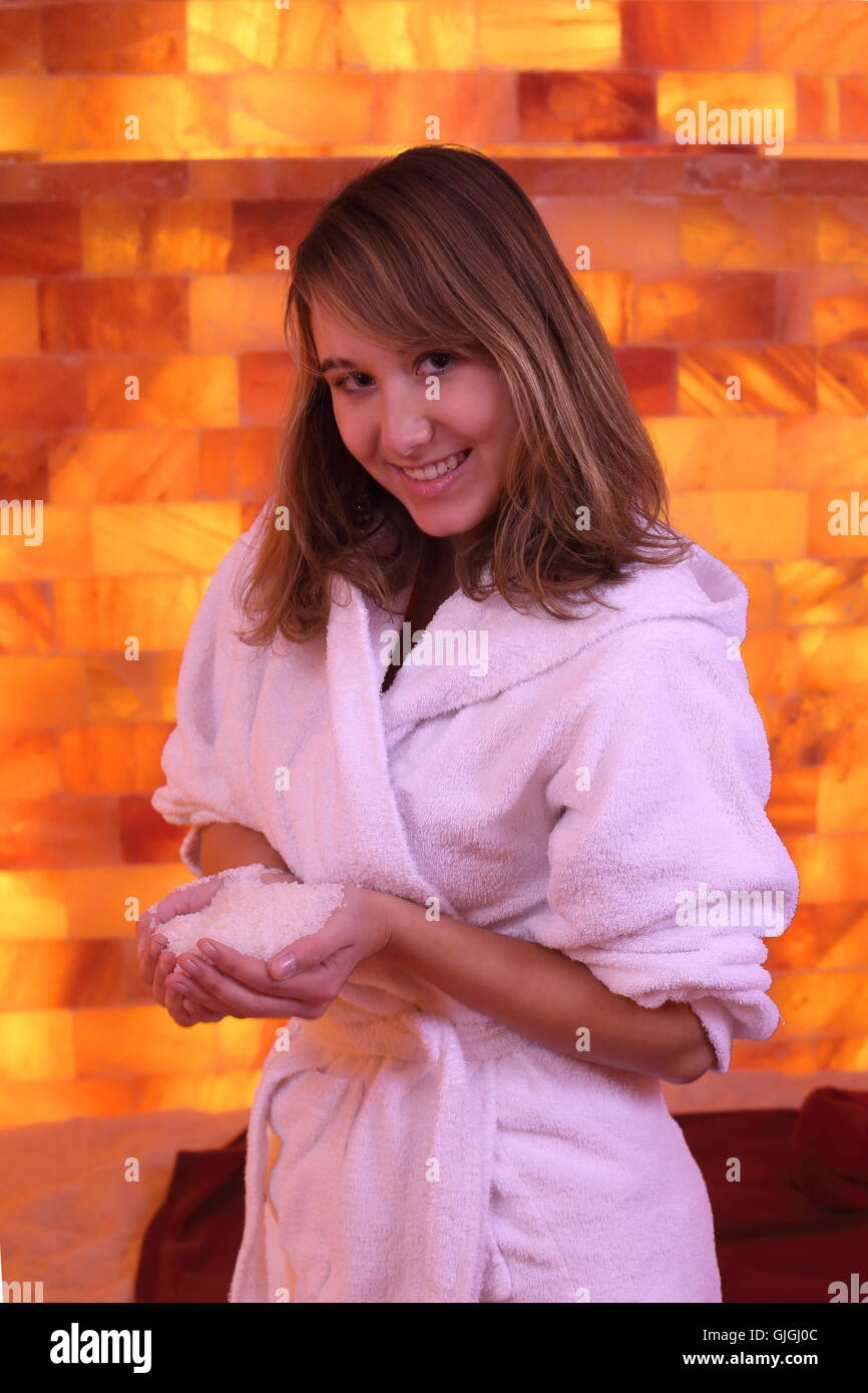 A Woman in Salt room with salt in hands - Stock Image