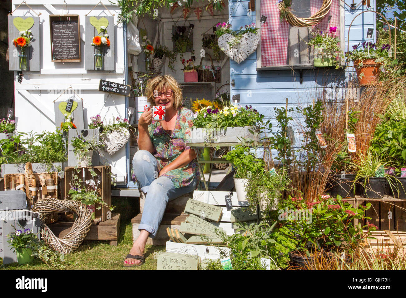 Southport Flower Show, Merseyside, UK. 17th Aug 2016: Louise Campbell taking a well earned break after finalising - Stock Image