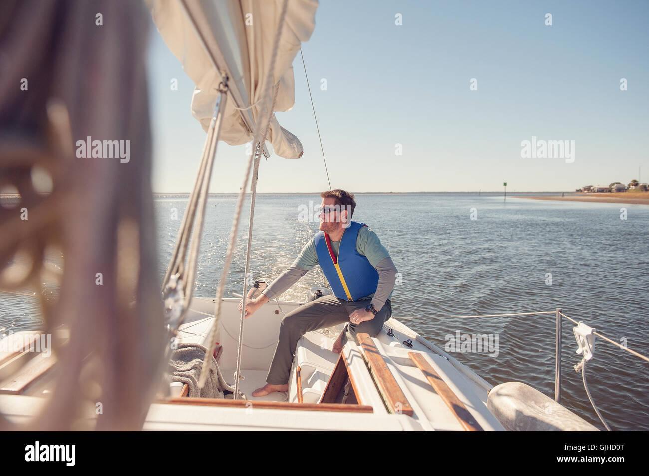 Man sailing sailboat, Florida, America, USA - Stock Image
