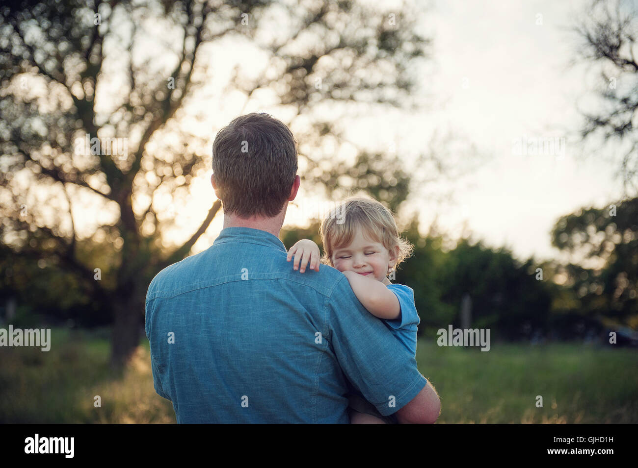 Father carrying his son Stock Photo