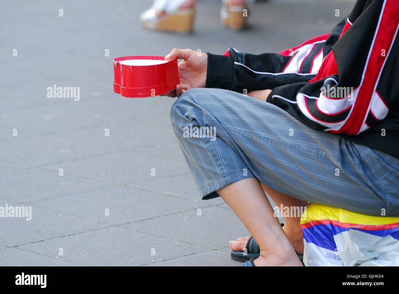affliction emergency beg - Stock Image