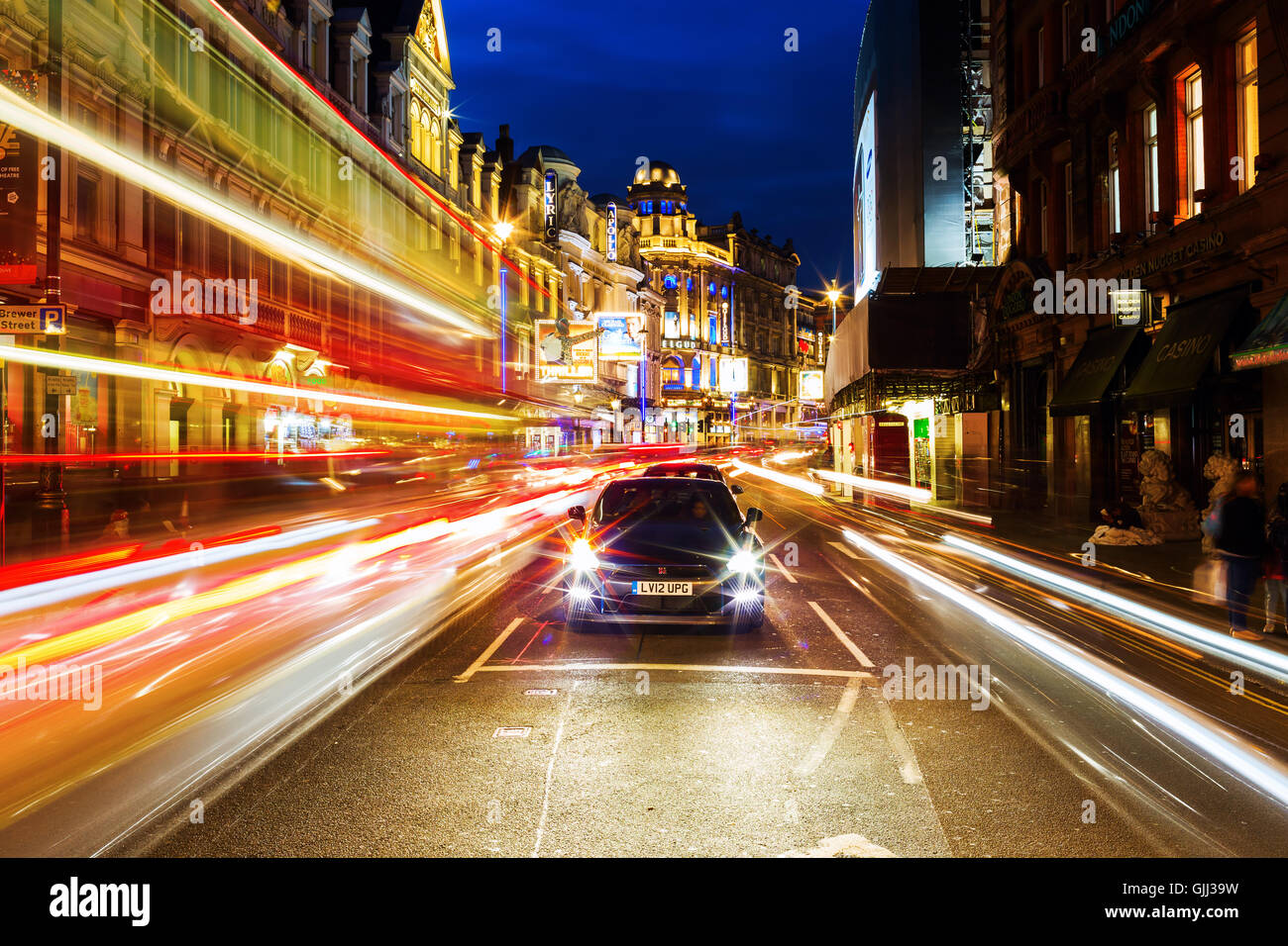Shaftesbury Avenue in London, UK, at night - Stock Image