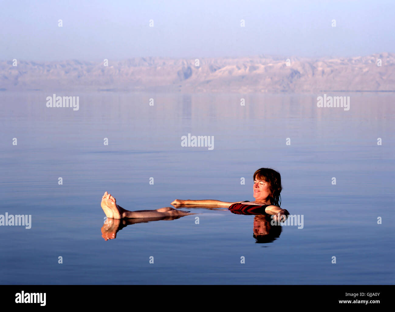 Girl floating at the Dead Sea, Jordan - Stock Image