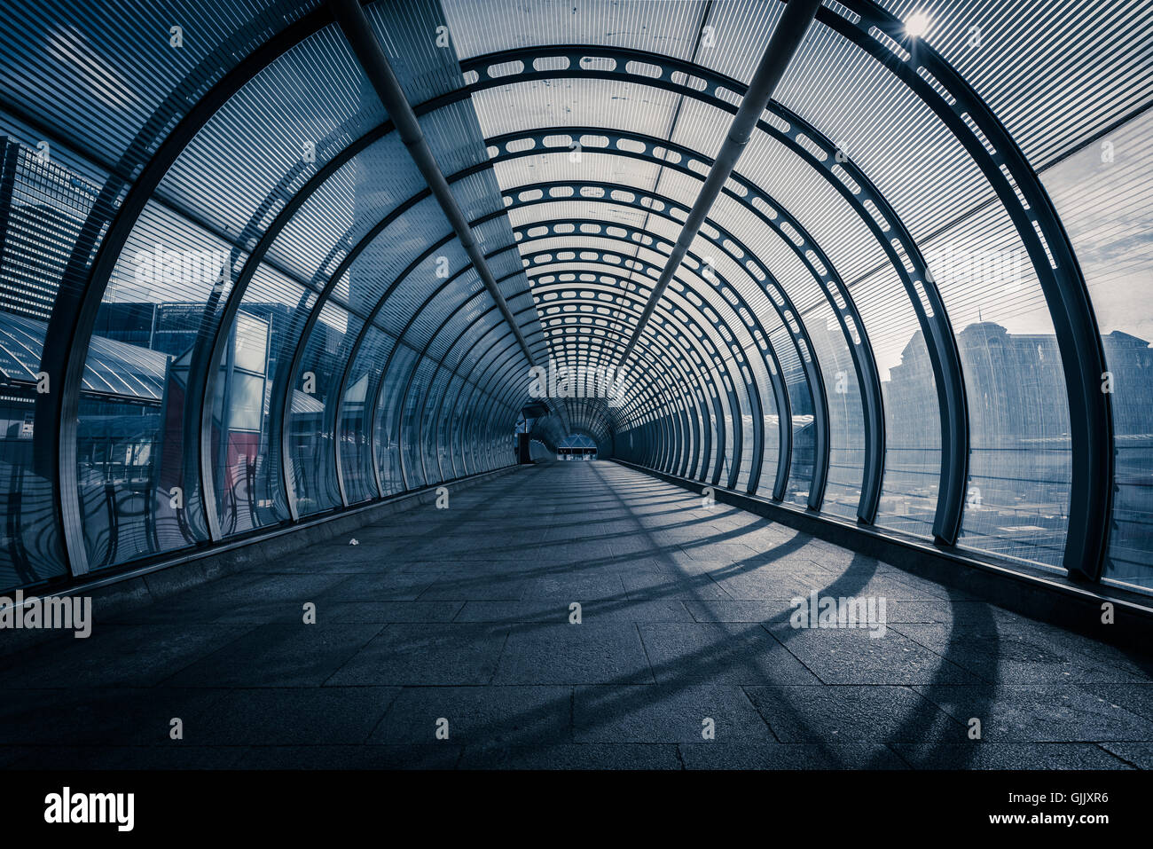 Poplar tunnel / walkway at DLR Docklands Light Railway station, London, United Kingdom - Stock Image
