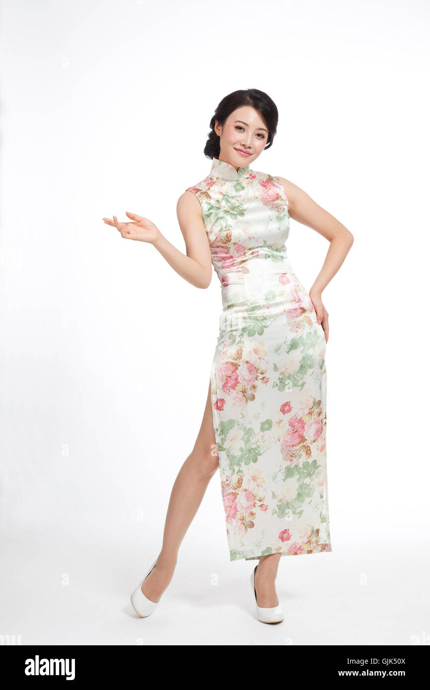 56ccdc055 Dressed in traditional Chinese costumes studio shot young woman ...