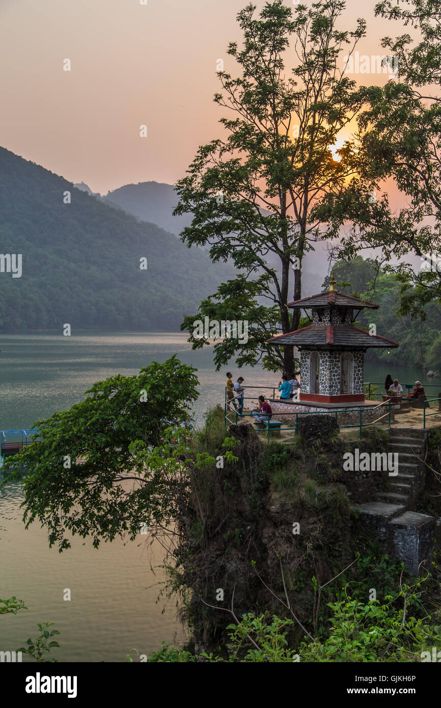 Temple on the lake at sunset in Pokhara, Nepal - Stock Image