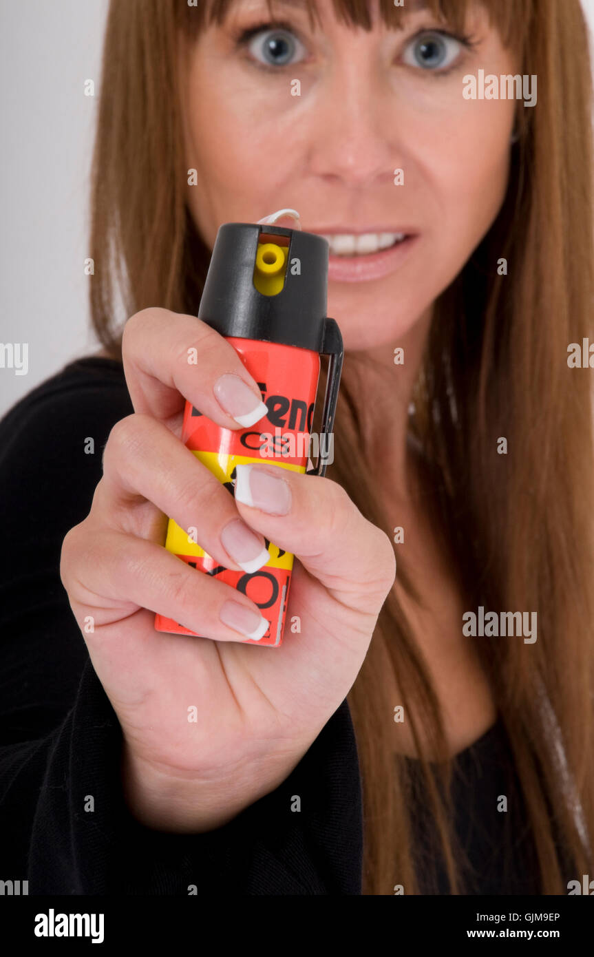 woman with cs gas - Stock Image