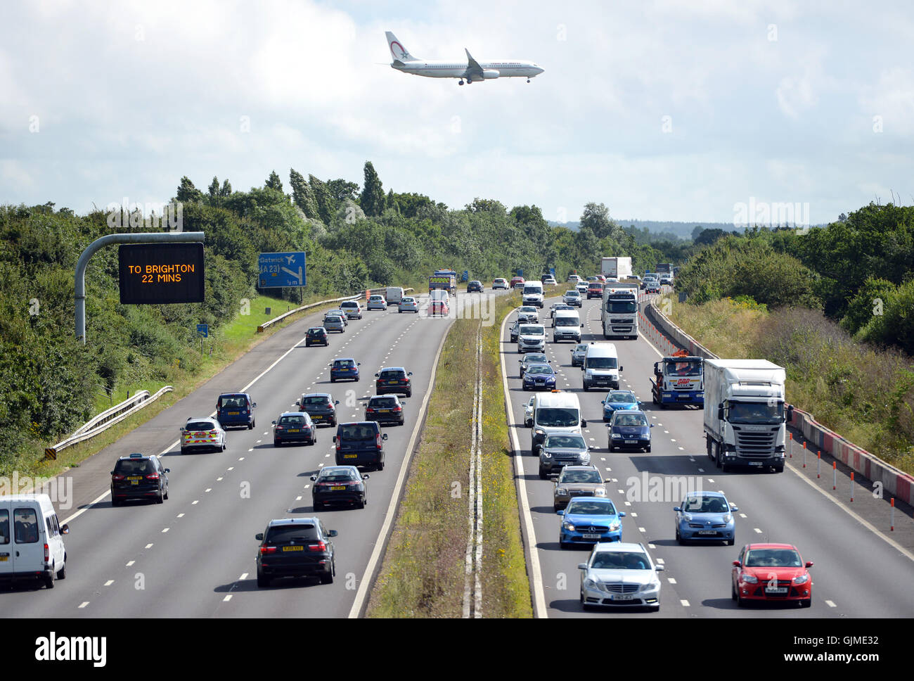 Plane over A23, coming in to land at London Gatwick airport - Stock Image