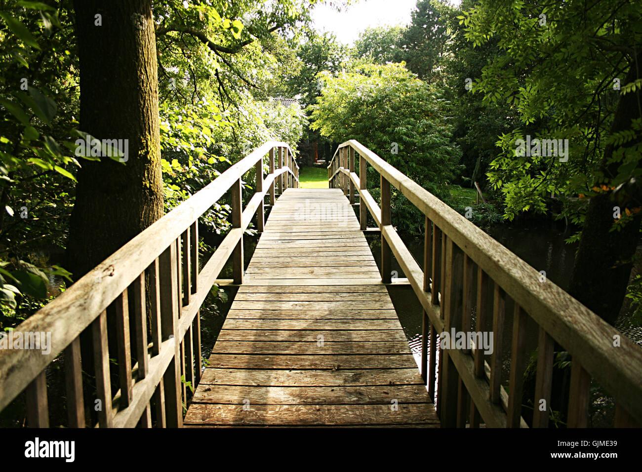 bridge over the creek - Stock Image