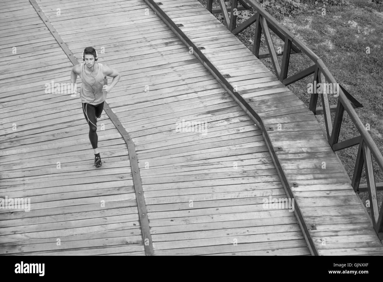black and white one man runner jogger elevated view above high Stock Photo