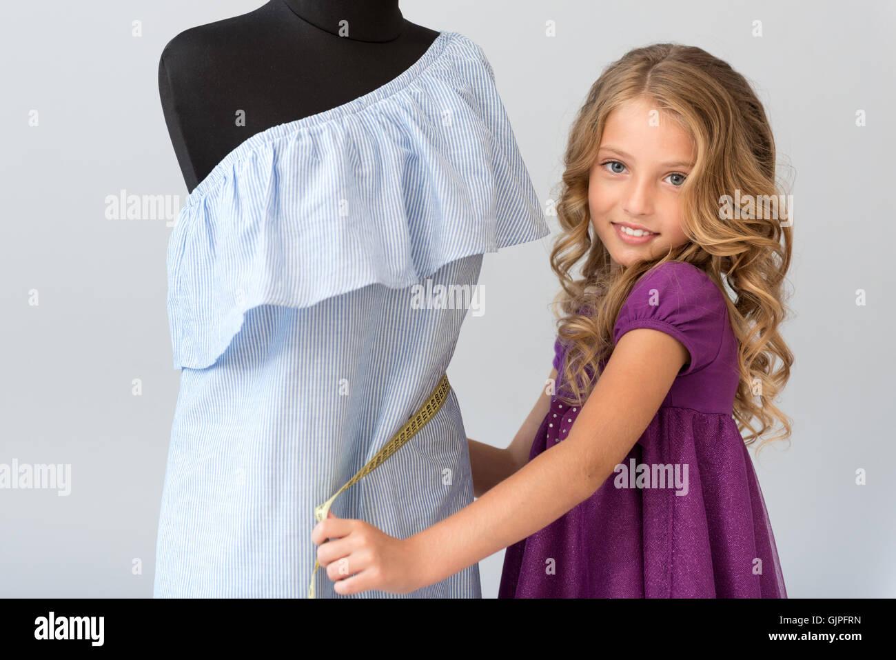 Fascinating girl taking waist measurement - Stock Image