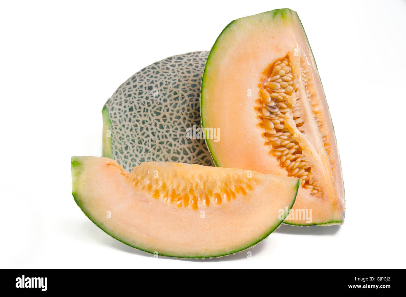 Cucumis melo or melon with half and seeds on white (Other names are cantelope, cantaloup, honeydew, Crenshaw, casaba, - Stock Image
