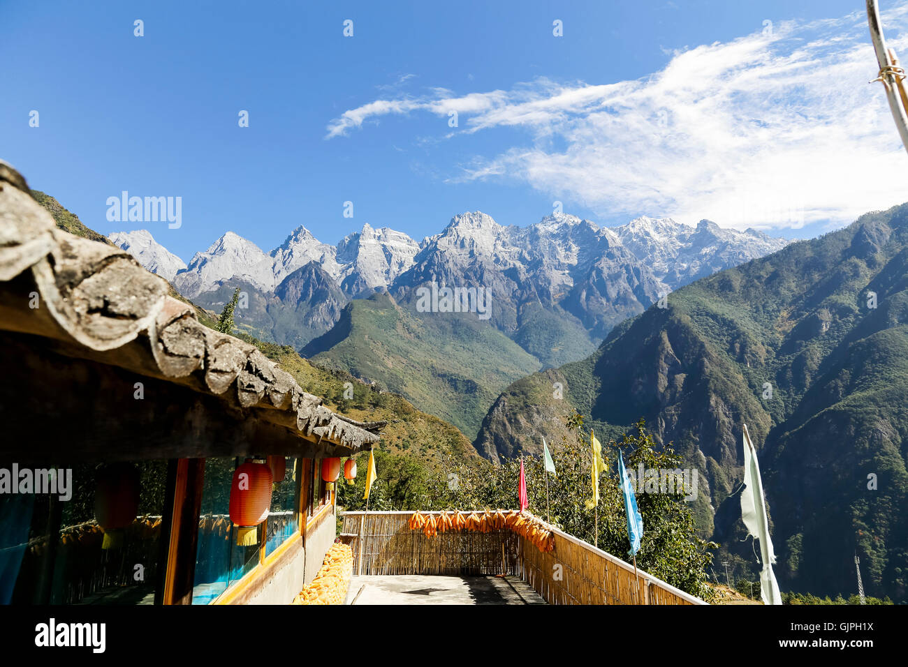 View of the Jade Dragon Snow Mountains from the terrace of Naxi Family Guest House, Tiger Leaping Gorge, Yunnan, - Stock Image
