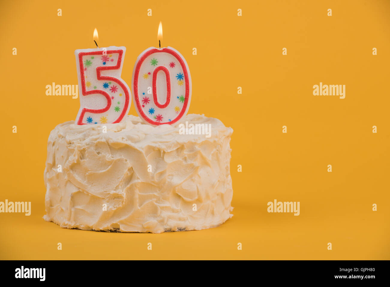 White Frosted Cake With 50 Candles Stock Photo 114822512 Alamy