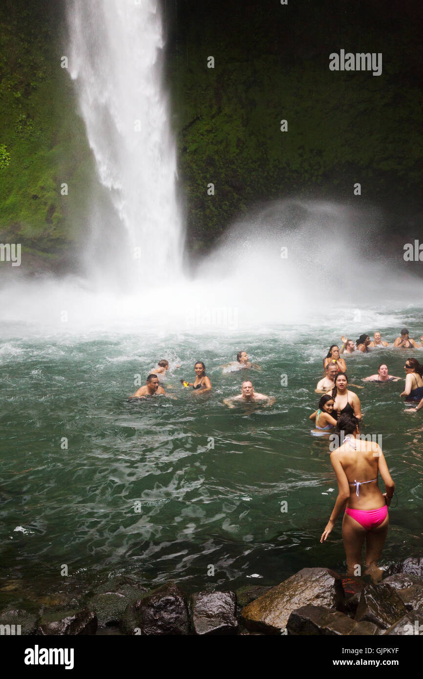 Tourists swimming in la Fortuna waterfall, La Fortuna, Arenal province, Costa Rica, Central America - Stock Image