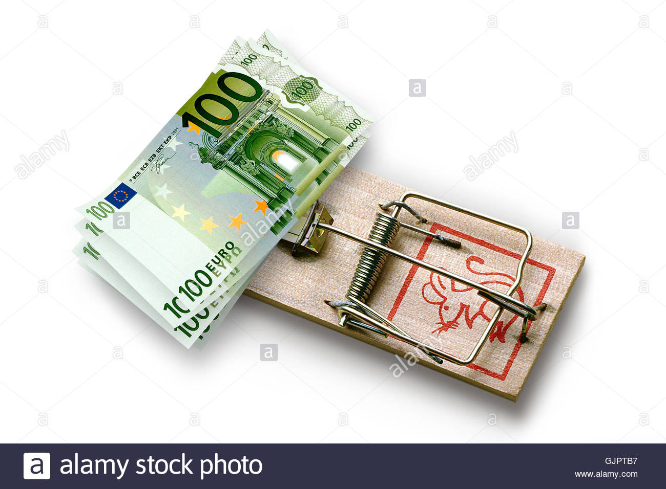 Euro banknotes on a mousetrap as bait. - Stock Image