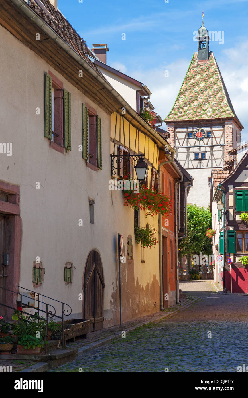 Half-timbered clock tower in Bergheim, Alsace France Stock Photo