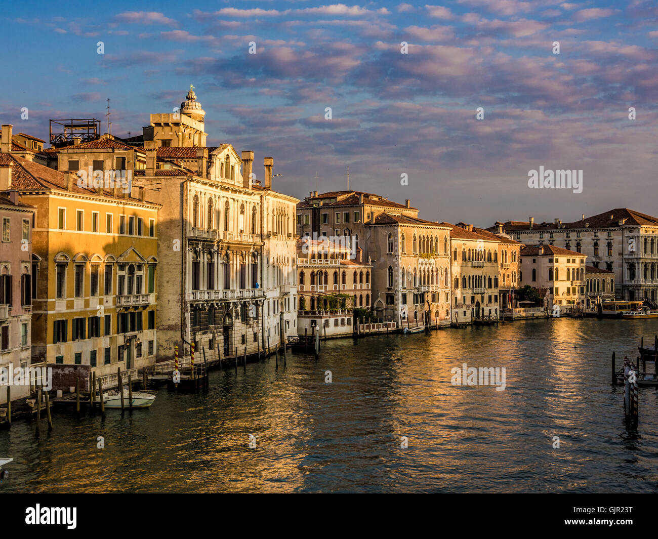 Traditional venetian buildings along the Grand Canal, at sunrise. Venice. Italy. - Stock Image