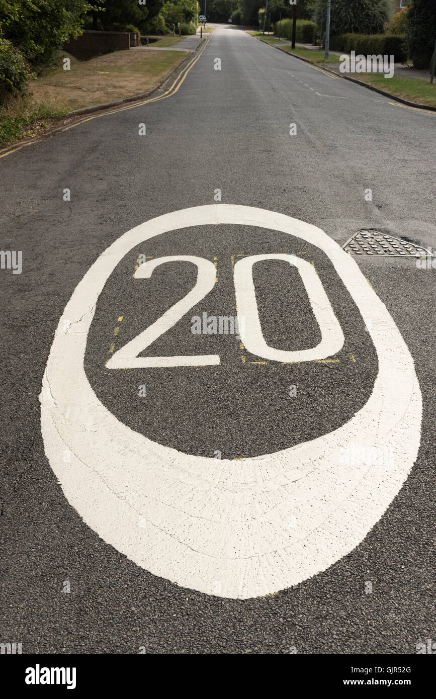 Close up wide angle view of 20 miles per hour mph speed limit signs painted on a road in Cambrudge UK - Stock Image
