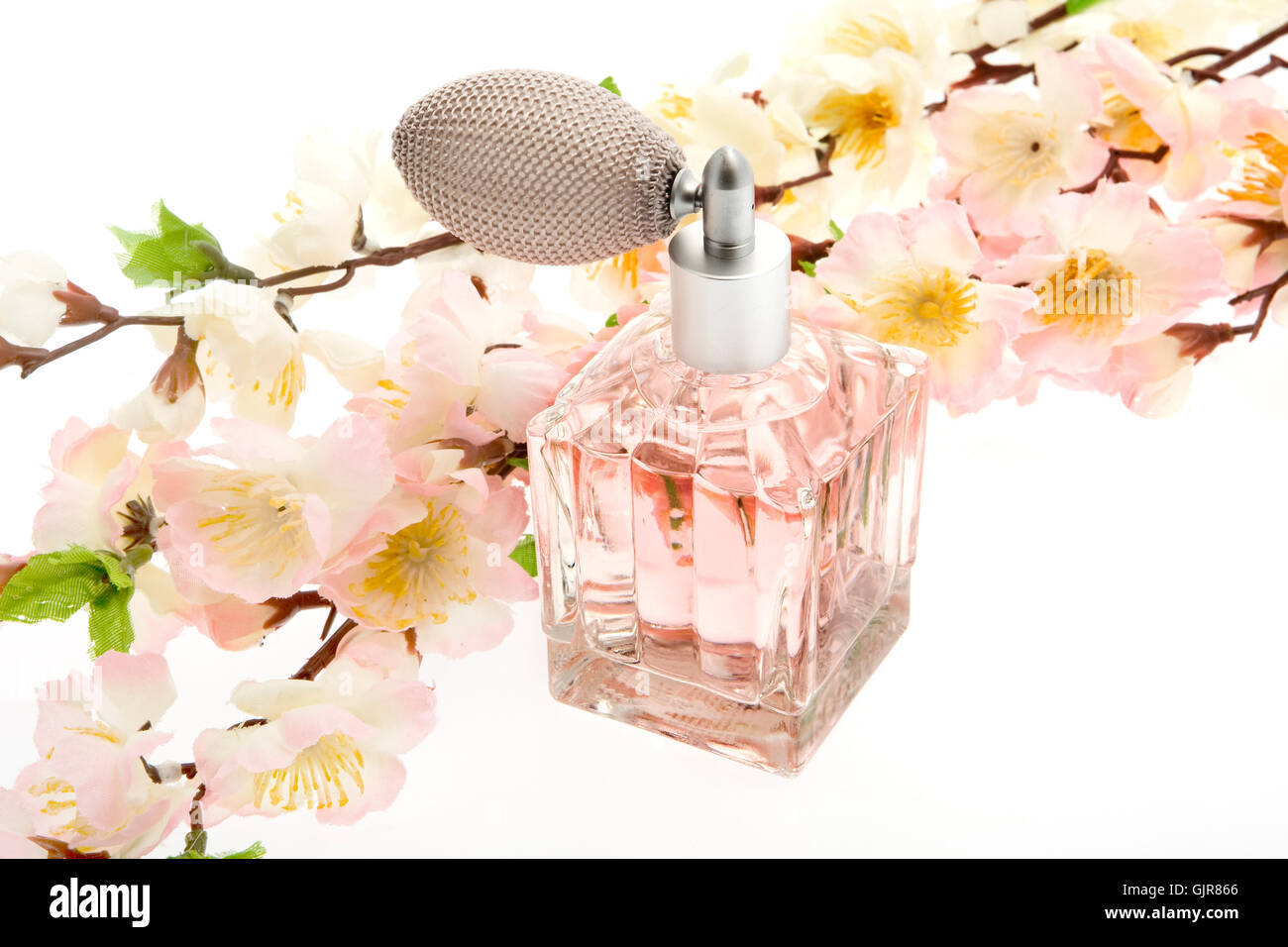 perfume,pink bottle with cherry blossoms - Stock Image
