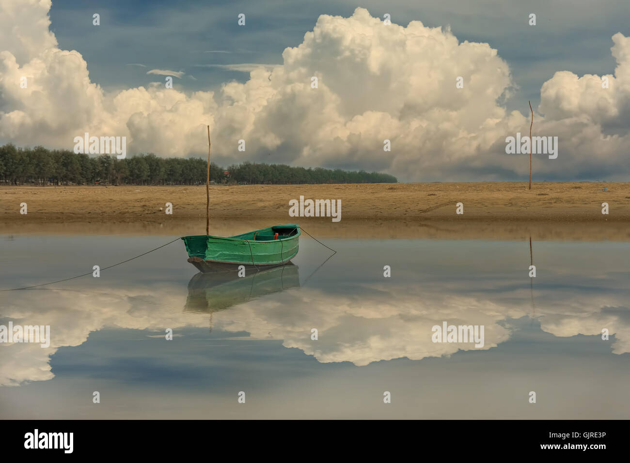 Sky, clouds, water reflections boats moor. - Stock Image