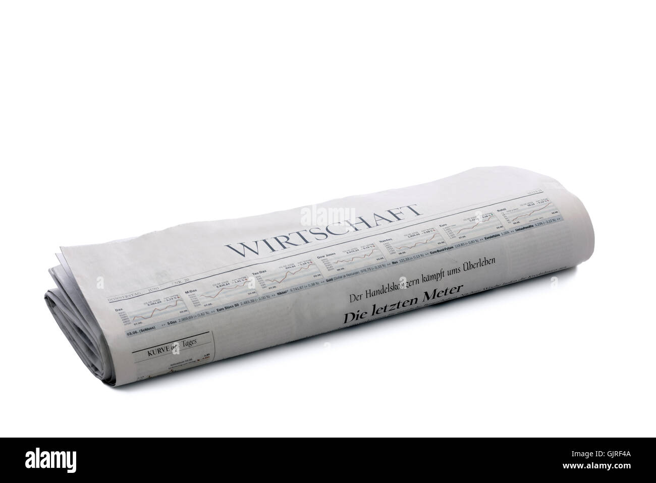 rolled up newspaper business - Stock Image