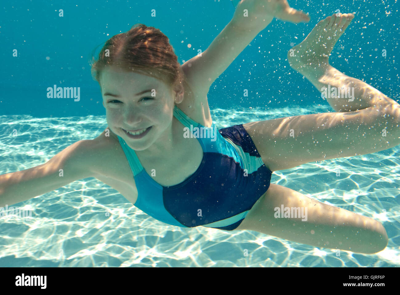 girl emerges and smiles - Stock Image