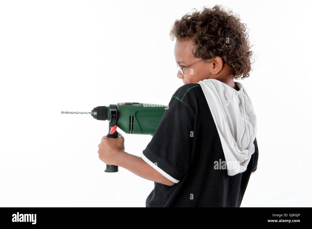 boy with drilling machine - Stock Image