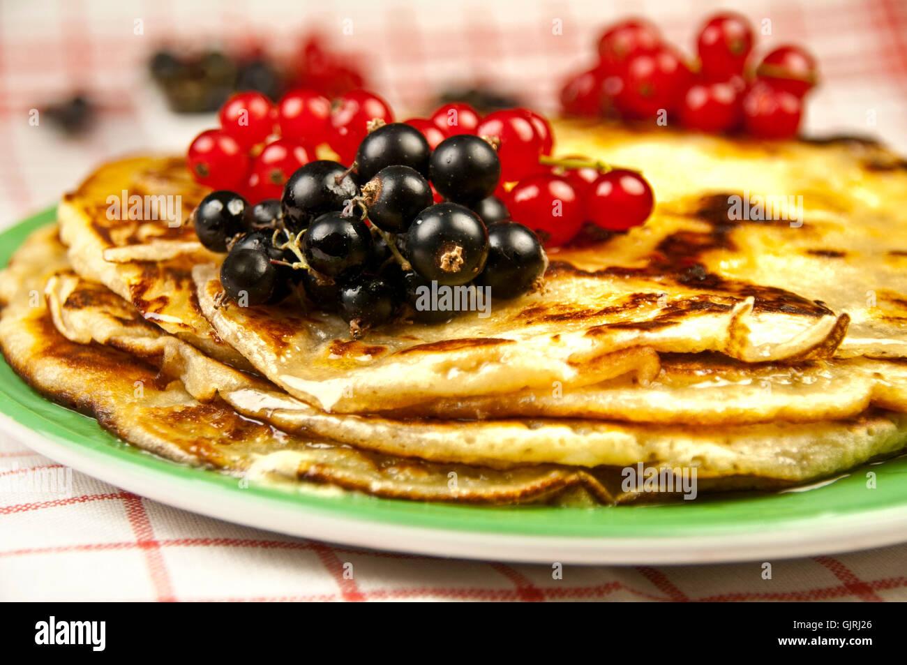 black currants pancakes pancake - Stock Image