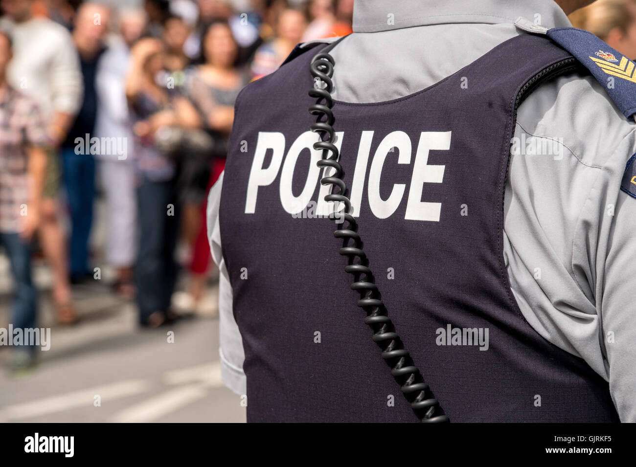 Montreal, CA - 14 August 2016: Back of the bulletproof vest of a Royal Canadian Mounted Police sergeant Stock Photo