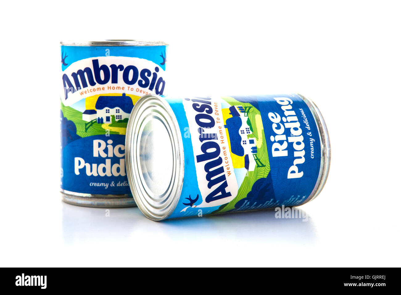 Two tins of Ambrosia rice pudding on a white background - Stock Image