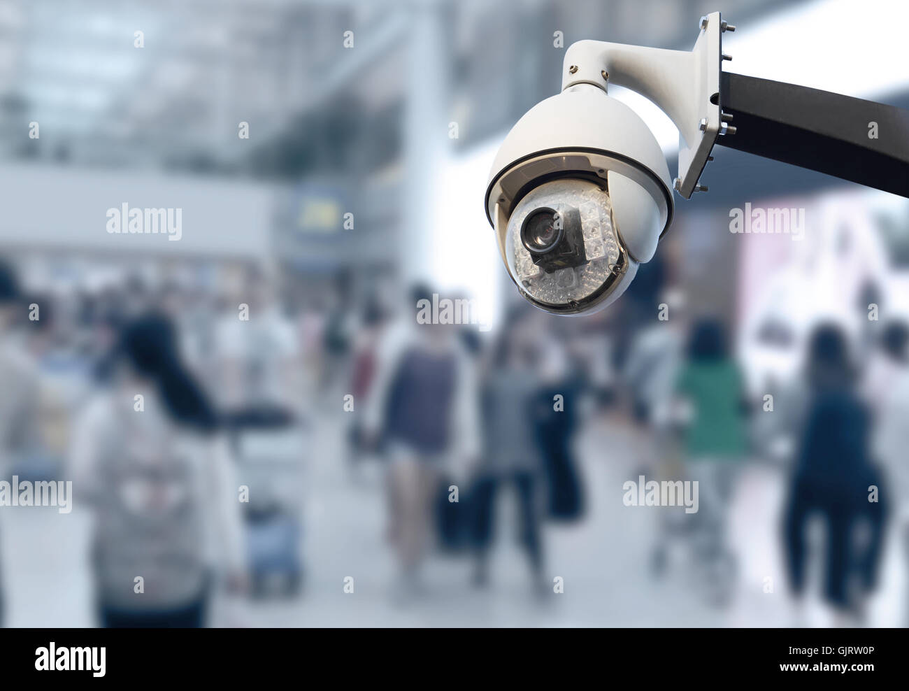 closeup image of CCTV security camera and blurred background - Stock Image