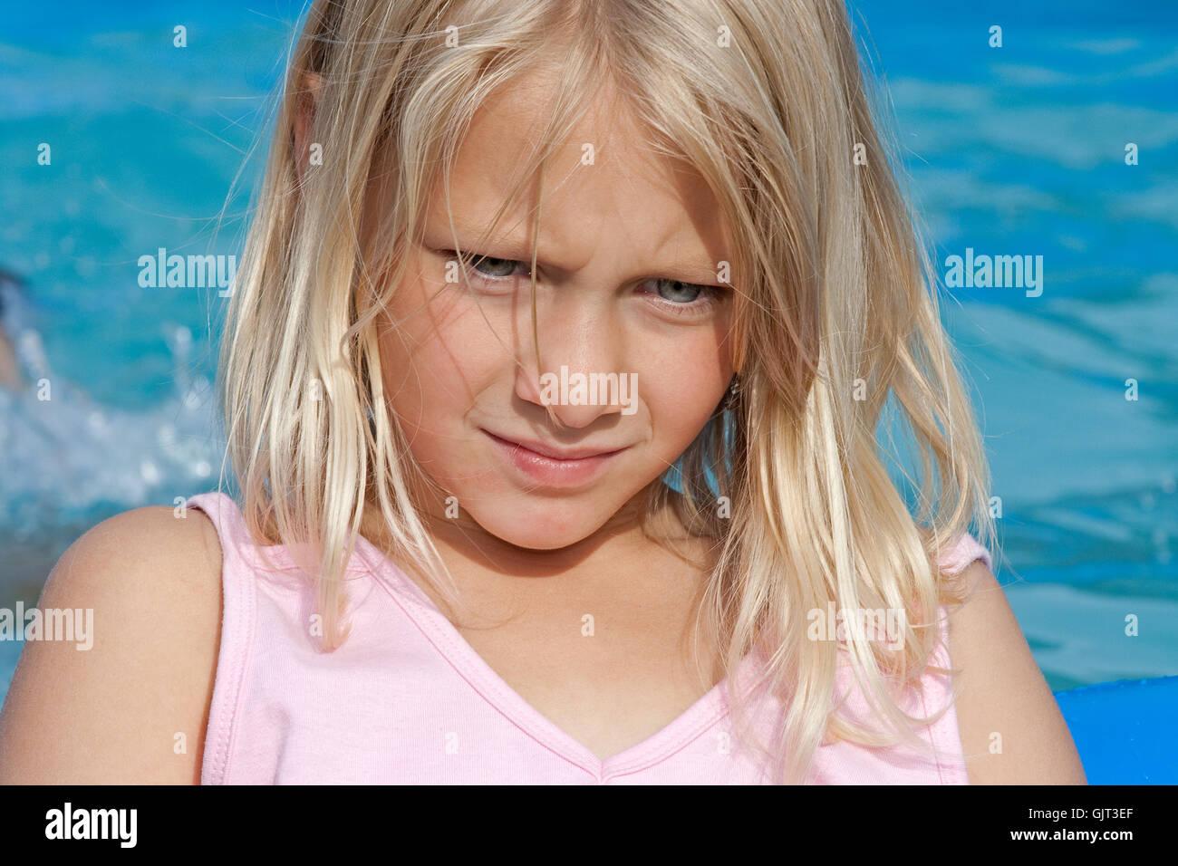 blue pool annoyed - Stock Image