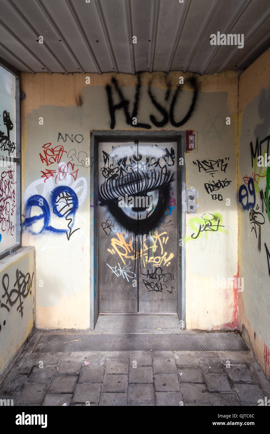 Graffiti covers the doors and surrounds of a carpark lift in Nicosia in Cyprus - Stock Image